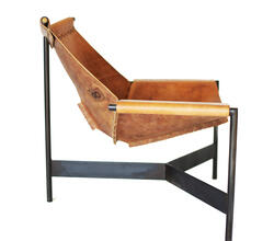 The Home Chair is a handcrafted accent chair built from blackened mild steel and harness leather